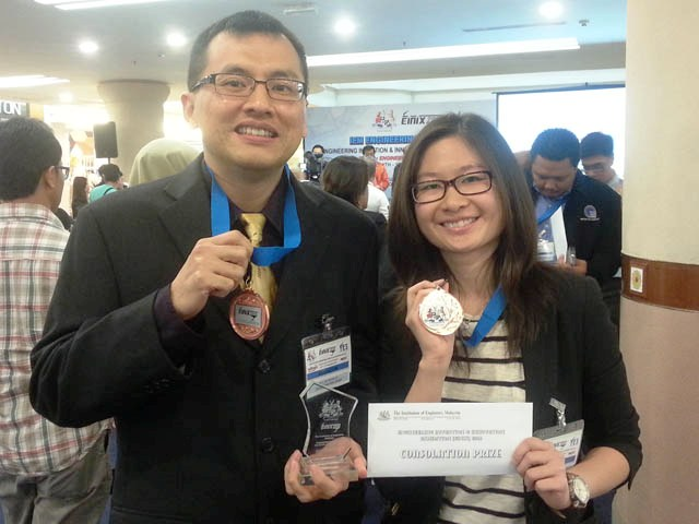 Dr Lim (left) and Wong smiling for the camera with their prize