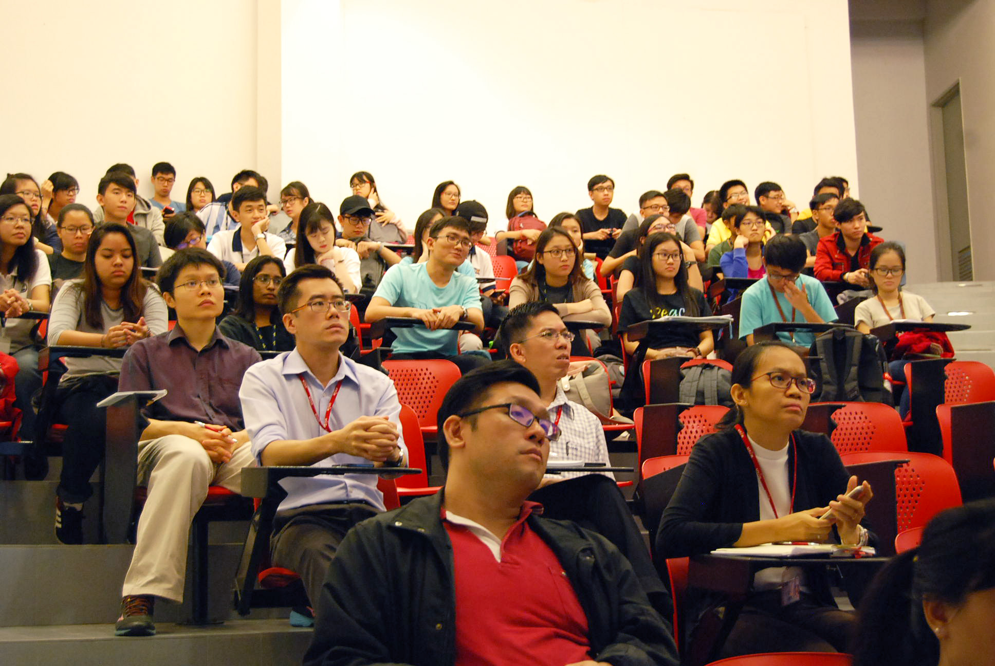 Staff and participants listening attentively to Stuart Soo